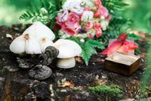 Wedding Rings, Bouquet And Mushrooms On Hemp