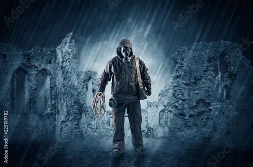 Hazard, menace man in a ruined crumbly building with arms on his hand Wallpaper Mural