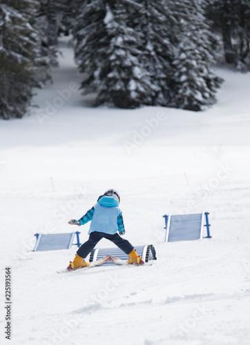 Boy on skis learning basic skills