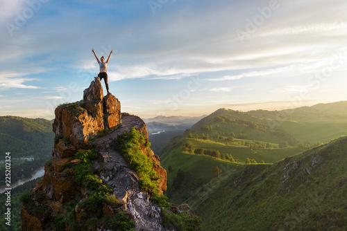 Fotografiet  Woman on top mountain in Altai, sunset light, beauty summer landcape