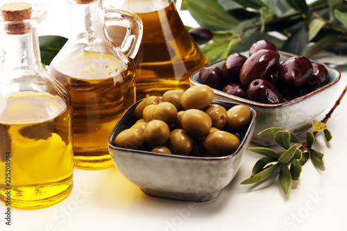 Fotobehang Aromatische Olives. Bottle virgin olive oil and oil in a bowl with some olives