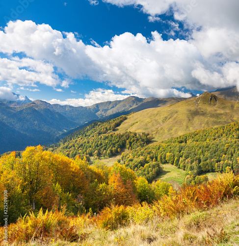 Spoed Foto op Canvas Oranje beautiful panorama mountain landscape with blue sky and white clouds