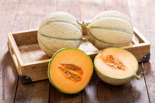 cantaloupe melon on wooden table