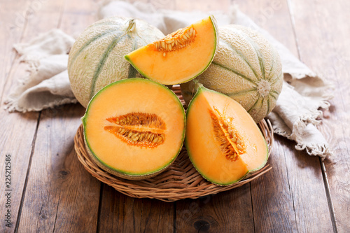 Fototapeta cantaloupe melon on wooden table
