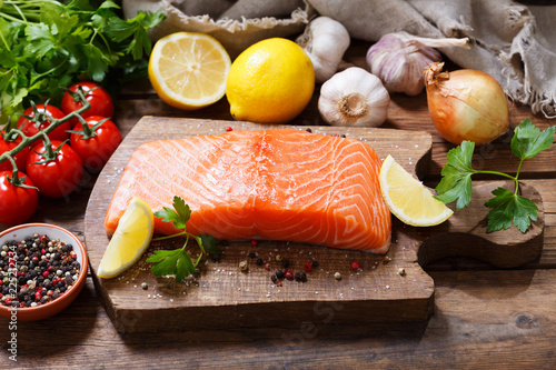 fresh salmon steak with ingredients for cooking