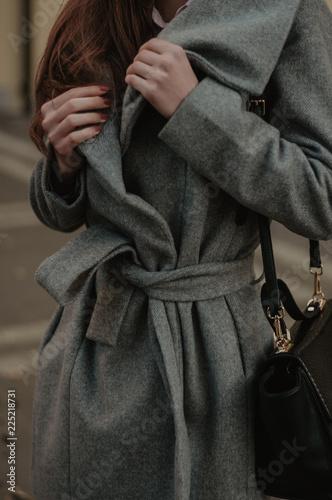Fotografie, Tablou  Woman holding her autumn coat closeup. Fashion style