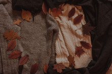 Autumn Leaves On The Cozy Sweaters Top View. Copy Space