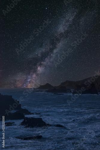 Foto op Aluminium Nachtblauw Vibrant Milky Way composite image over landscape of long exposure sea over rocks