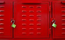 Closeup F Red Lockers Doors And Two Brass Padlocks.