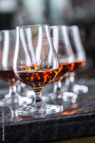 Cups with a cognac rum brandy or whiskey drink.