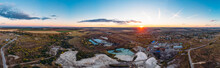 Aerial Panorama Of Industrial Chalk Quarry Or Chalkpit For Limestone Mining And Beautiful Nature Landscape At Sunset, View From Above