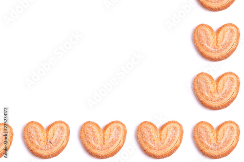 Tuinposter Koekjes Frame of cookies hearts isolated on white background, place for text