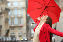 Spontaneous Woman Celebrating Under The Rain In Winter