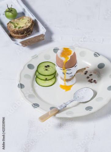Boiled Eggs and Wholemeal Bread and Vegetables on White Rustic Background