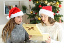 Disappointed Woman Receiving A Gift In Christmas