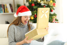 Amazed Woman Opening A Gift Box On Christmas