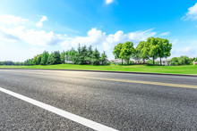 Asphalt Highway And Green Forest Natural Scenery Under The Blue Sky