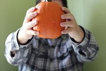 Man Holding A Pie Pumpkin