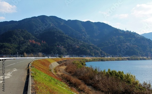 A paved road on the riverbank of the Kuma River in Japan Poster Mural XXL