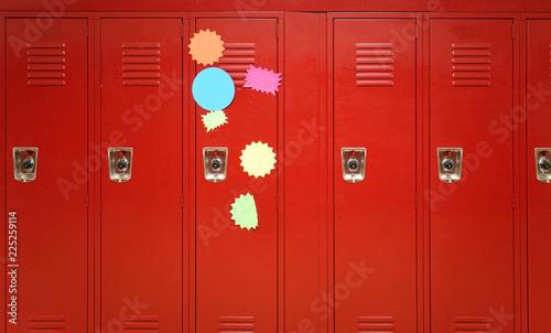 Fotografia, Obraz Colorful stickers on red lockers in the school