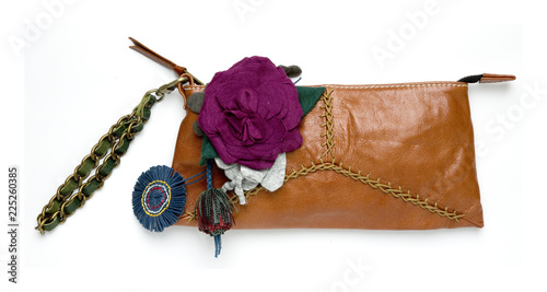 Valokuva Leather wristlet bag with fabric flowers decoration, isolated on white background with clipping mask
