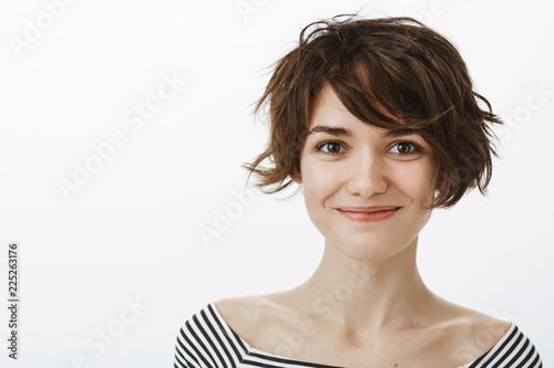 Valokuva  Close-up shot of friendly joyful attractive female with short stylish harcut and