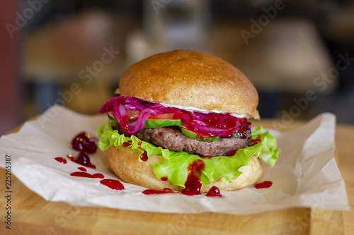 Fotomural  Meat Burger with pickled onions, cutlet and cranberry jam on wooden Board