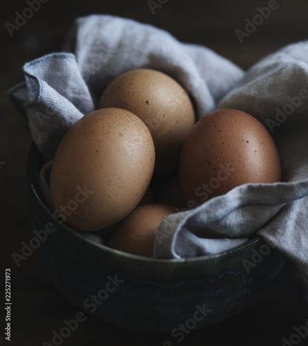 Fresh hen eggs on black background