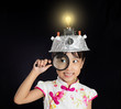 Asian chinese little girl holding magnifier with virtual reality helmet