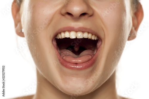 Fotografia, Obraz young woman with open mouth on white background
