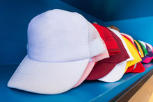 Colorful Cap On Blue Shelf Background. Fashion Baseball Or Hiphop Hat.
