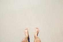 Male Bare Feet Stand On White Coastal Sand