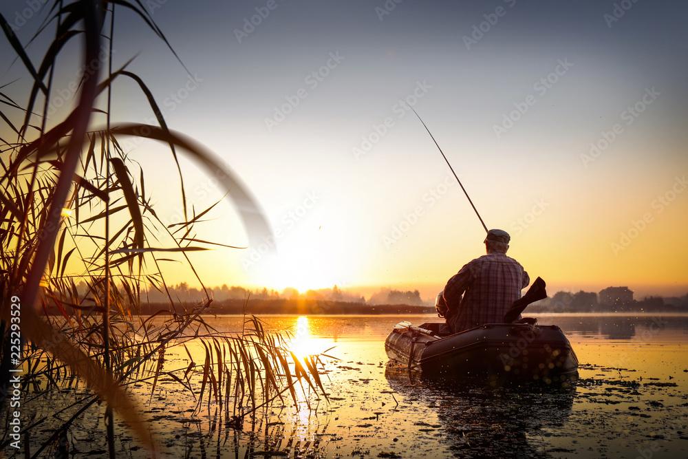 Fototapeta Fishing. Sunset on the lake.