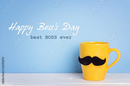 Foto Boss day background with yellow mug with a mustache on blue.