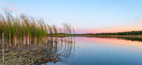 Fotobehang Blauwe hemel Landscape of the lake at colorful sunset