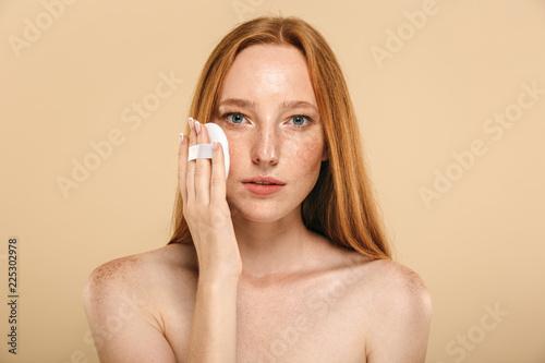 Obraz Beauty portrait of a pretty young redhead topless woman - fototapety do salonu