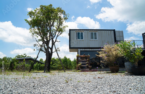 Modern metal building made from shipping house containers and blue sky background Wallpaper Mural