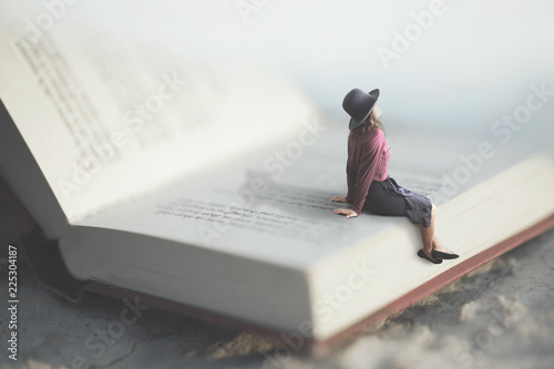 surreal moment of a woman relaxes sitting on a giant book