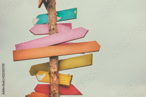 Fotografering Colorful wooden direction arrow signs