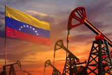 Venezuela Oil Industry Concept. Industrial Illustration - Venezuela Flag And Oil Wells With The Red And Blue Sunset Or Sunrise Sky Background - 3D Illustration