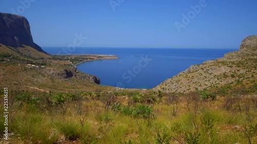 Rocky mediterranean coastline in Sicily, Italy.