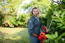 Handsome Young Man Gardener Tr...
