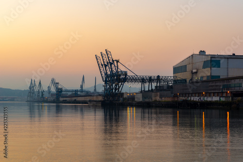 Fotobehang Poort Cranes along the River Nervion in the industrial North of Bilbao, Basque Country, Spain