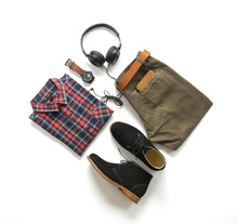 Men's Casual Outfits For Man Clothing With Ankle Boot , Watch, Sunglasses, Trousers, Earphone, Shirt And Wallet Isolated On White Background, Top View. Pack Shot