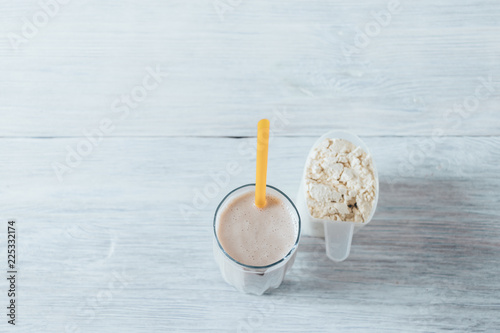 Obraz na plátně  Whey protein shake in glass with straw