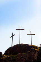 Three Big Christian Crosses Outside In Blue Sky