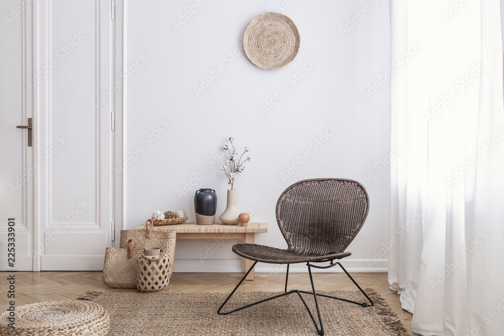 Fototapety, obrazy: Modern armchair and pouf on brown carpet in white apartment interior with door. Real photo