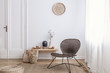 canvas print picture - Modern armchair and pouf on brown carpet in white apartment interior with door. Real photo