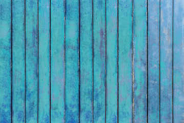 Old green plank rows nicely for a background or backdrop.  The empty wall is used for decorating or displaying work.