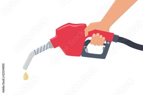Obraz na płótnie Hand holding a fuel pump. Yellow drop of oil